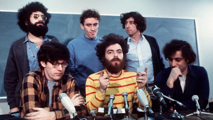 """Feb. 1970: If ever a modern American trial deserved to be called a circus in a courtroom, it was the case of the """"Chicago Seven."""" Front row: Rennie Davis, Jerry Rubin, Abbie Hoffman. Back row: Lee Weiner, Bob Lamb and Thomas Hayden. Lamb was not one of the """"Chicago Seven."""""""