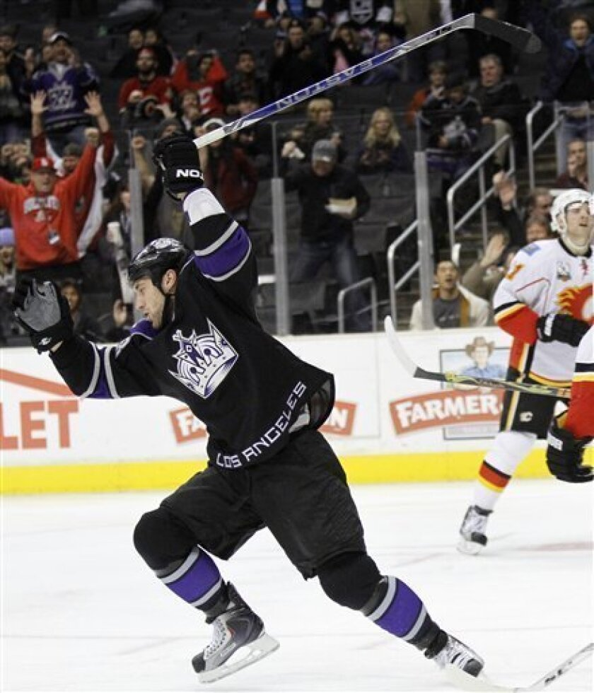 Los Angeles Kings center Jarret Stoll reacts after scoring a goal against the Calgary Flames in the second period of a NHL hockey game in Los Angeles, Monday, Dec. 7, 2009. (AP Photo/Lori Shepler)