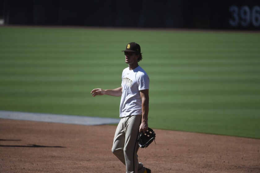 Wil Myers walks in from the outfield during a summer camp workout at Petco Park.