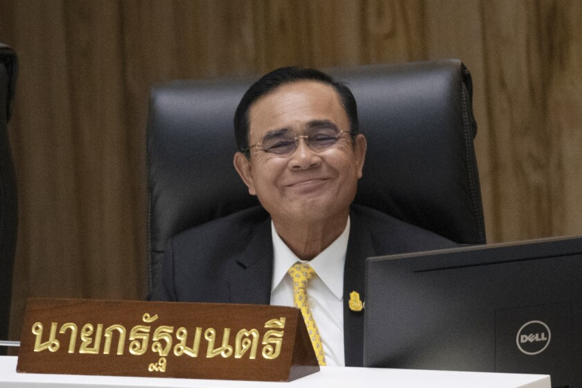 Thailand's Prime Minister Prayuth Chan-ocha smiles before answering a question at parliament in Bangkok, Thailand, Wednesday, Sept. 18, 2019. Prayuth has come under fire in a parliamentary debate because he omitted a key phrase in taking his oath of office in July, but dodged opposition demands to explain why he had left it out. (AP Photo/Sakchai Lalit)