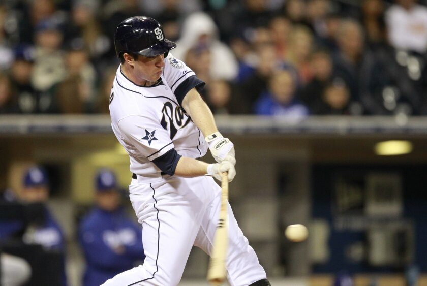Padres second baseman Jedd Gyorko connects on a pitch earlier this season.