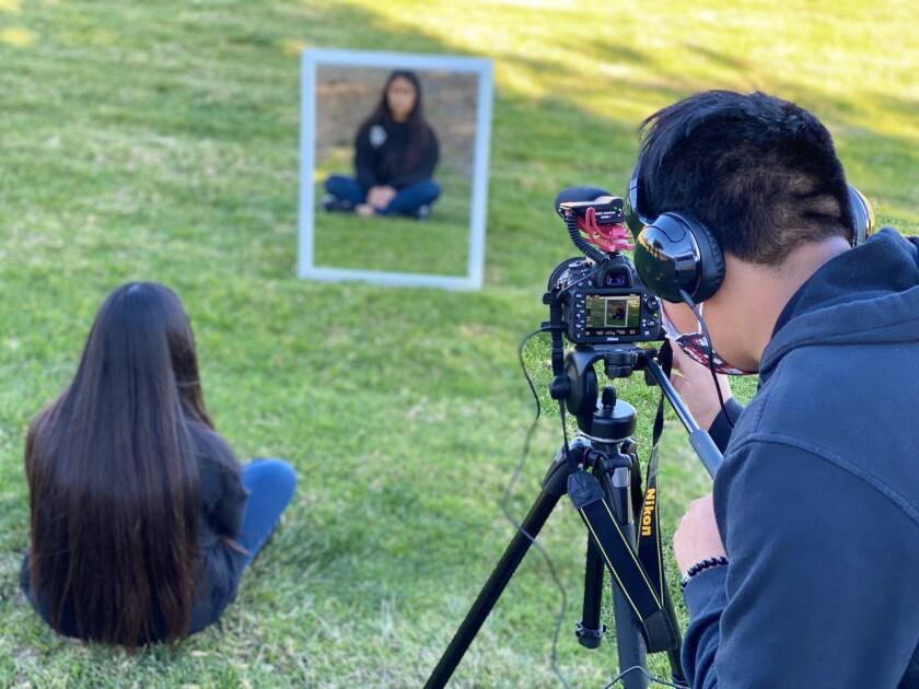 "Student videographer Jesus Aquino films Natalie Lopez for Rancho Minerva Middle School's ""The Pep Talk."""