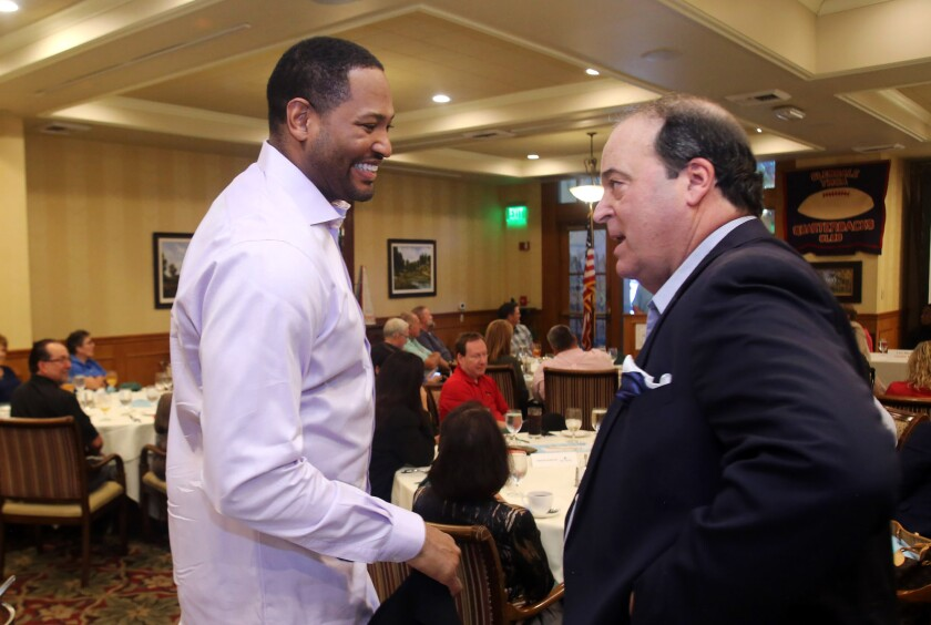 Robert Horry, former NBA basketball player and winner of seven NBA championship titles is welcomed by Spiro Psaltis to the YMCA Quarterback Club Meeting at the Oakmont Country Club banquet facility in Glendale, Ca., Tuesday, October 15, 2019. (photo by James Carbone)