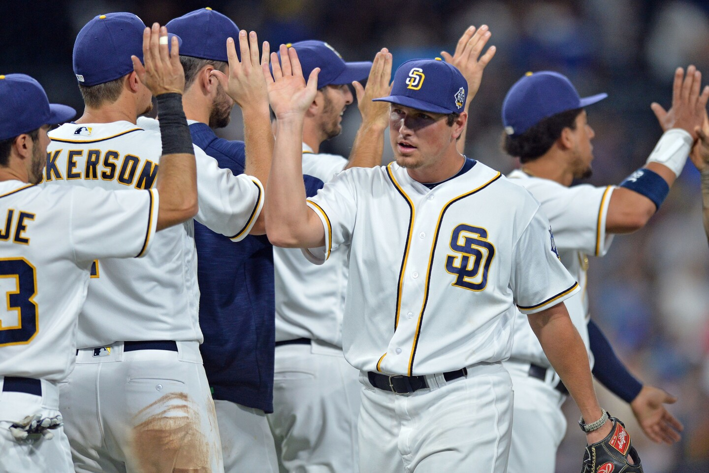 Sep 28, 2016; San Diego, CA, USA; San Diego Padres right fielder Hunter Renfroe (center) celebrates a 6-5 win over the Los Angeles Dodgers with teammmates at Petco Park. Mandatory Credit: Jake Roth-USA TODAY Sports ** Usable by SD ONLY **