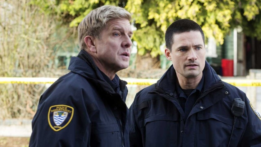 """Kenny Johnson, left, and Warren Christie  in """"Motive"""" on ABC."""