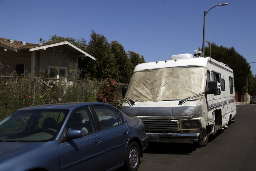Los Angeles is considering ways to limit people sleeping in vehicles on city streets. Above, a homeless man's RV in Venice in 2014.