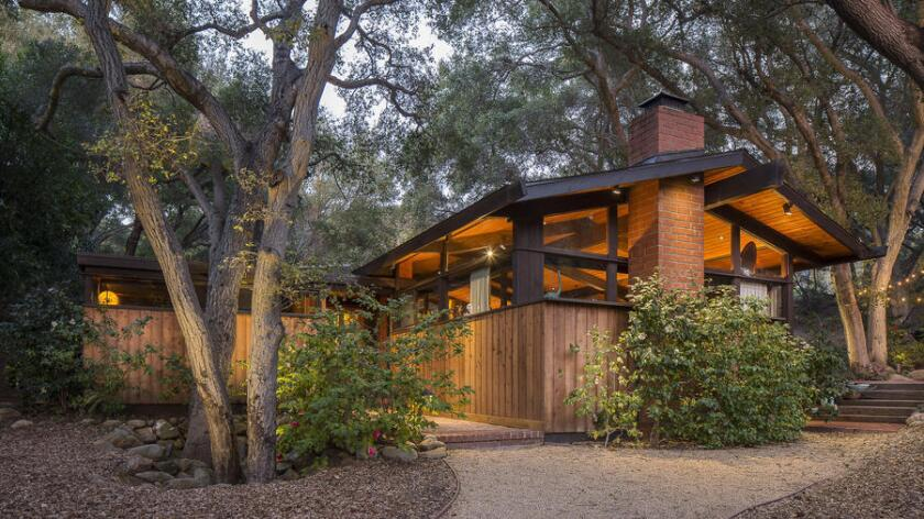 The 1970s post-and-beam, designed by Donald Rucker and recently renovated by Dan Meis, sits on more than an acre in Calabasas.