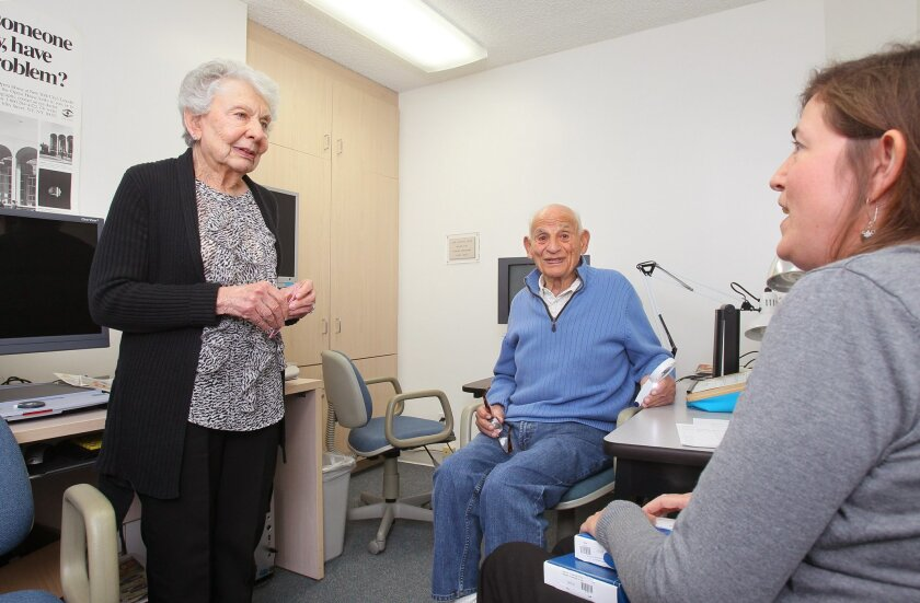 Mary Gagliardo, 82, left, long time volunteer here at the Vista office of the San Diego Center for the Blind, chats with client Irving Roston, of Carlsbad, middle, and his vision therapist Kelly Malky, at right.