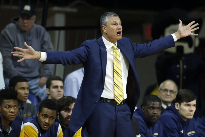 La Salle coach John Giannini gestures during the first half of the team's NCAA college basketball game against Temple on Wednesday, Jan. 20, 2016, in Philadelphia. (Yong Kim/The Philadelphia Inquirer via AP)