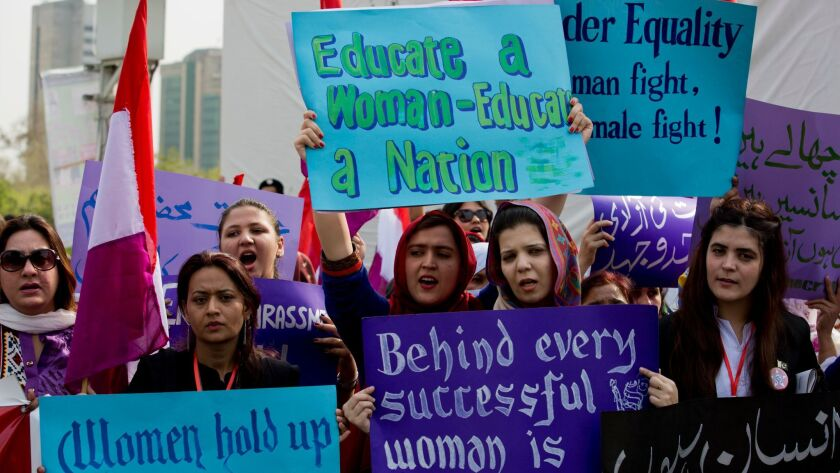 People take part in a rally to mark International Women's Day in Islamabad, Pakistan, Thursday, Marc