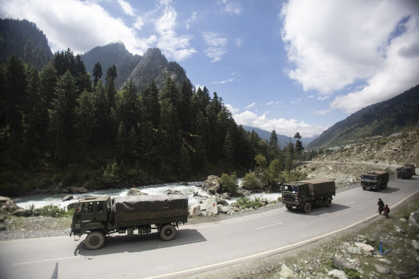 """An Indian army convoy moves on the Srinagar- Ladakh highway at Gagangeer, northeast of Srinagar, Indian-controlled Kashmir, Tuesday, Sept. 1, 2020. India said Monday its soldiers thwarted """"provocative"""" movements by China's military near a disputed border in the Ladakh region months into the rival nations' deadliest standoff in decades. China's military said it was taking """"necessary actions in response,"""" without giving details. (AP Photo/Mukhtar Khan)"""