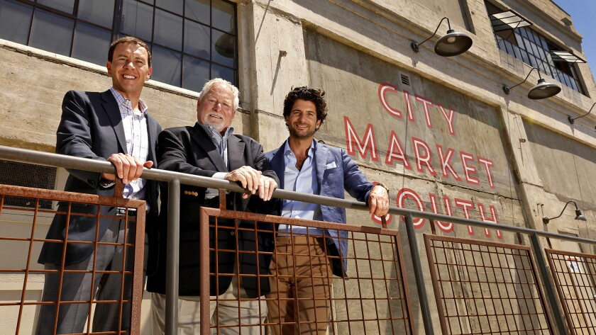 Mark Levy, left, President of City Market South, Peter Fleming, President of City Market LA, and Kev