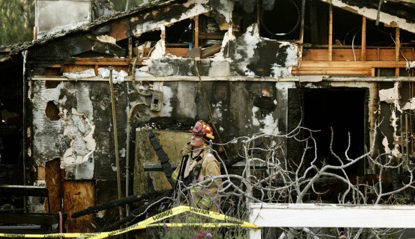San Diego Fire-Rescue Department Capt. Cliff Joralmon surveys the damage at the El Patio de Old Town restaurant and the two adjacent  buildings in Old Town, the result of a fire that was reported about 4:30 a.m. Monday.