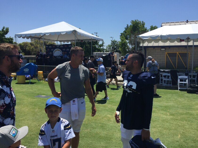 Rams safety Eric Weddle, right, chats with fellow San Diego County resident Philip Rivers before a joint practice in Orange County this month.