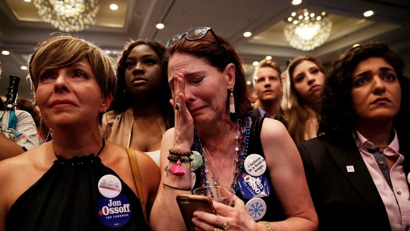 Supporter Jan Yanes cries as the Democratic candidate for Georgia's 6th Congressional District, Jon Ossoff, concedes to Republican Karen Handel at his election-night party in Atlanta on June 20.