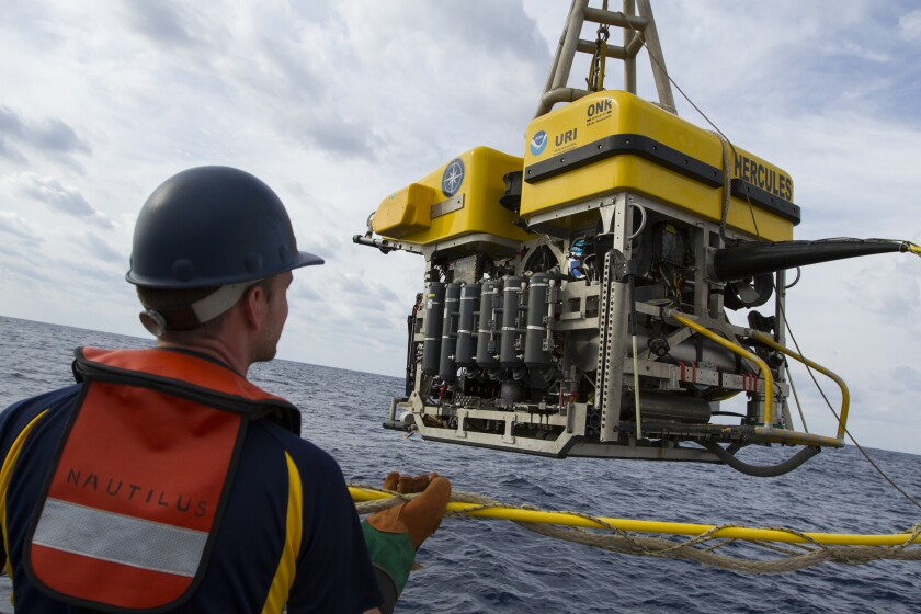 Scientists lower the ROV Hercules into the ocean to explore deep sea ridges and seamounts off Southern California