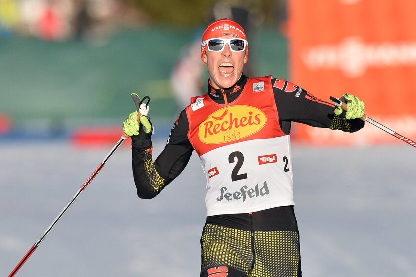 Germany's winner Eric Frenzel celebrates in the finish area after the Nordic Combined World Cup competition in Seefeld, Austria, Friday, Jan. 29, 2016. (AP Photo/Kerstin Joensson)