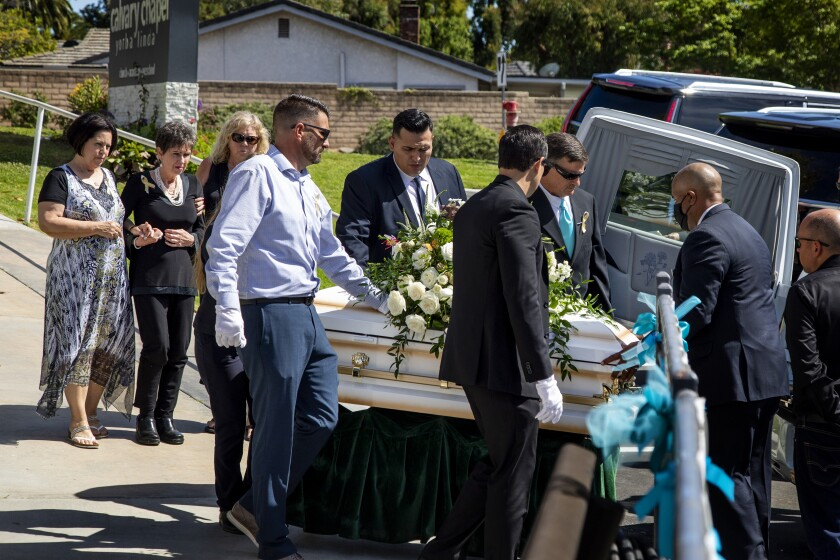 YORBA LINDA, CA - JUNE 5, 2021: Family members walk behind pallbearers carrying the casket of 6-year-old Aiden Leos after a funeral service at Calvary Chapel Yorba Linda on June 5, 2021 in Yorba Linda, California. Aiden was tragically killed while riding in his mom's car when someone fired a gun at the car on the 55 freeway in what is being called a road rage incident.(Gina Ferazzi / Los Angeles Times)