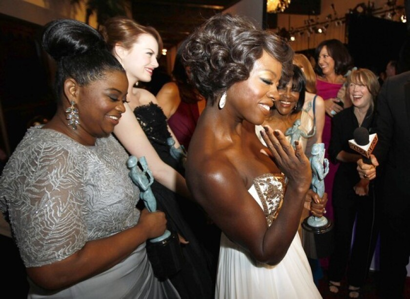 SAG award winners Octavia Spencer, left, and Viola Davis, center, at the Screen Actors Guild Awards show in Los Angeles.