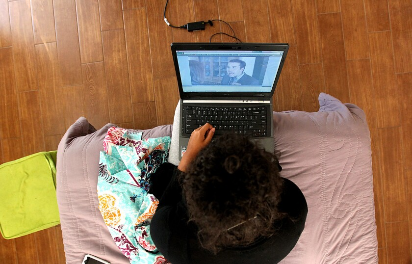 A USC student watches an episode of a television show on her laptop.