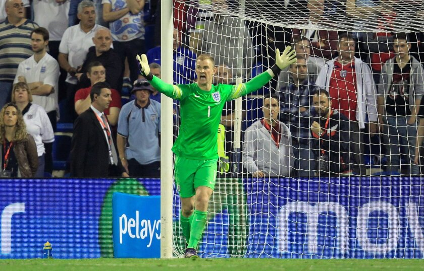 FILE - In this Friday, Nov. 13, 2015 file photo, England goalkeeper Joe Hart gestures after Spain scored their second goal during an international friendly soccer match between Spain and England at the Rico Perez Stadium in Alicante, Spain. (AP Photo/Alberto Saiz, File)