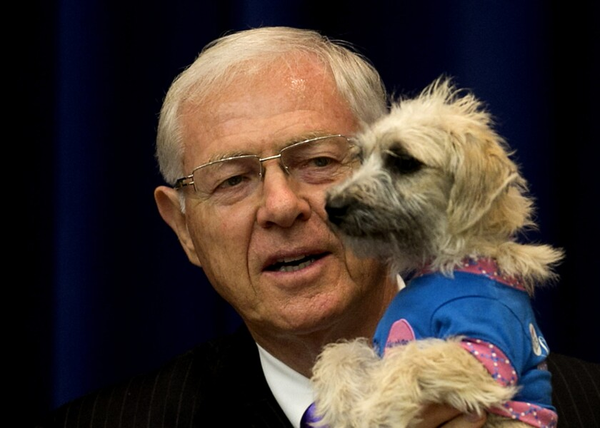 L.A. County Supervisors Hilda Solis and Michael D. Antonovich called Tuesday for a study of the county's animal control system. Above, Antonovich talks about pet adoption before a Board of Supervisors meeting in 2013.