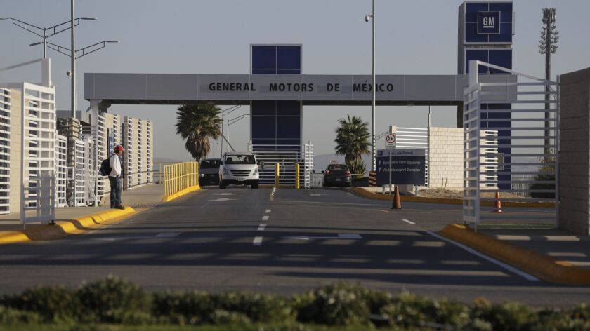 Cars leave the General Motors assembly plant in Villa de Reyes, Mexico, in January 2017. Aveo and Trax vehicles have been produced at the factory since 2008.