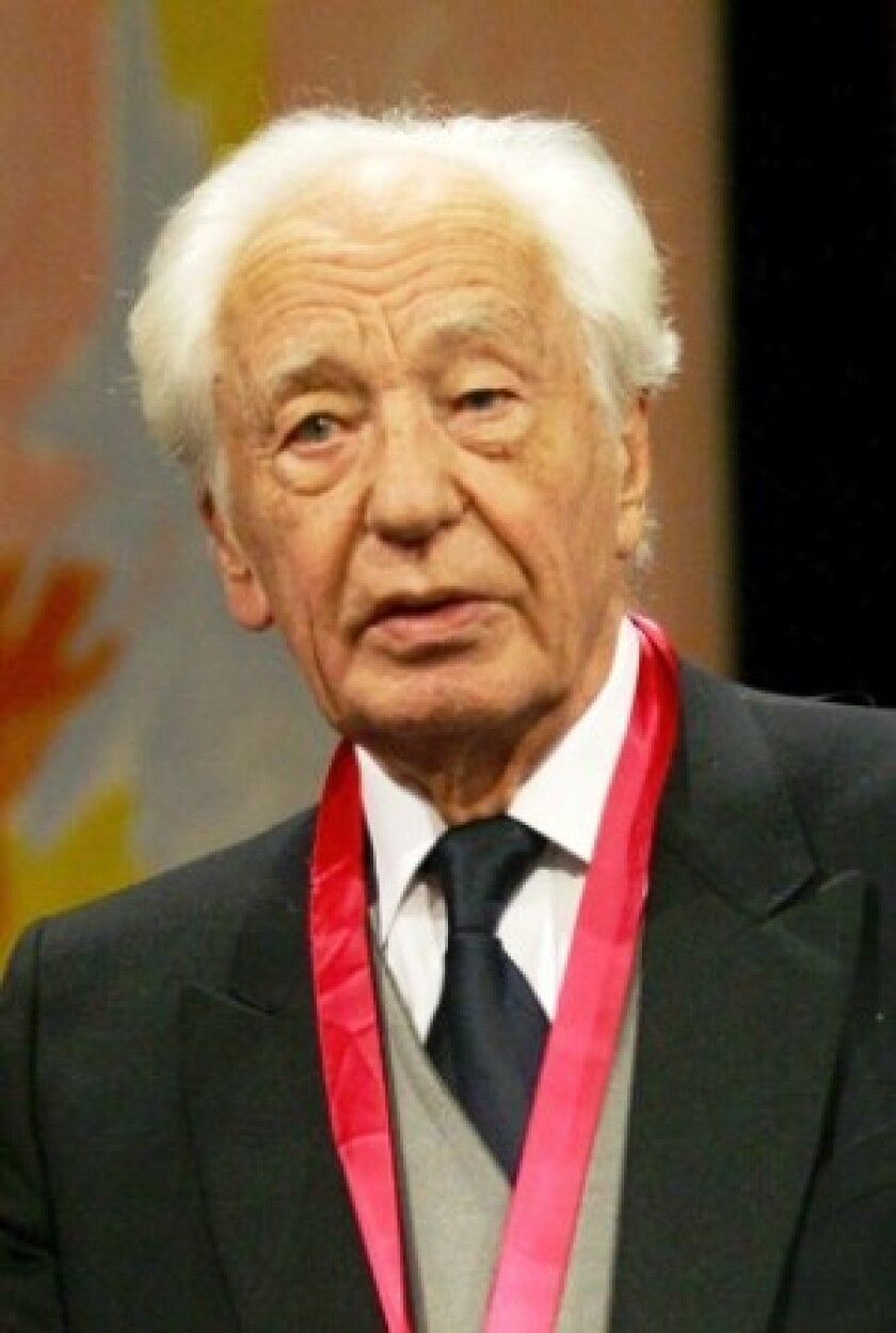 Dr. Jean Dausset receives an award in Spain. The French researcher, one of three recipients of the 1980 Nobel Prize in Medicine, discovered the human leukocyte antigen system on human tissue.