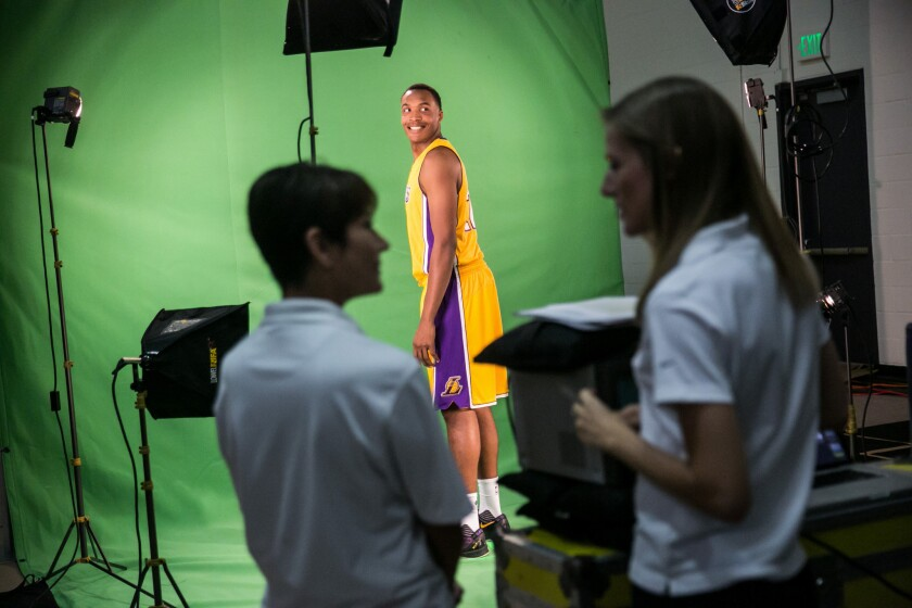 Lakers center Robert Upshaw smiles for the camera at a filming session during the Lakers' media day in El Segundo.