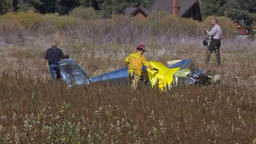 Investigators worked at the scene of a plane crash near Big Bear Lake.
