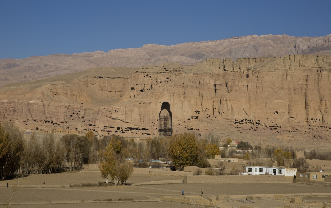 A towering gap in a mountain reveals a niche where one of the great Buddhas of Bamian once stood