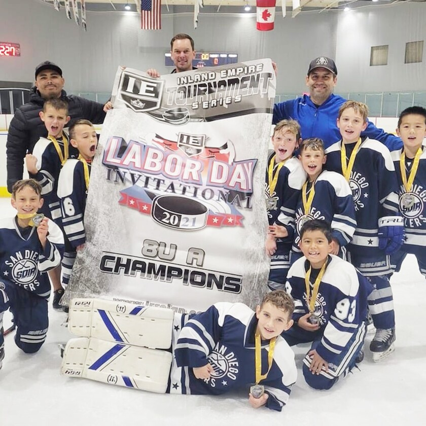 The San Diego Oilers 8U - A team members with their championship banner last month.