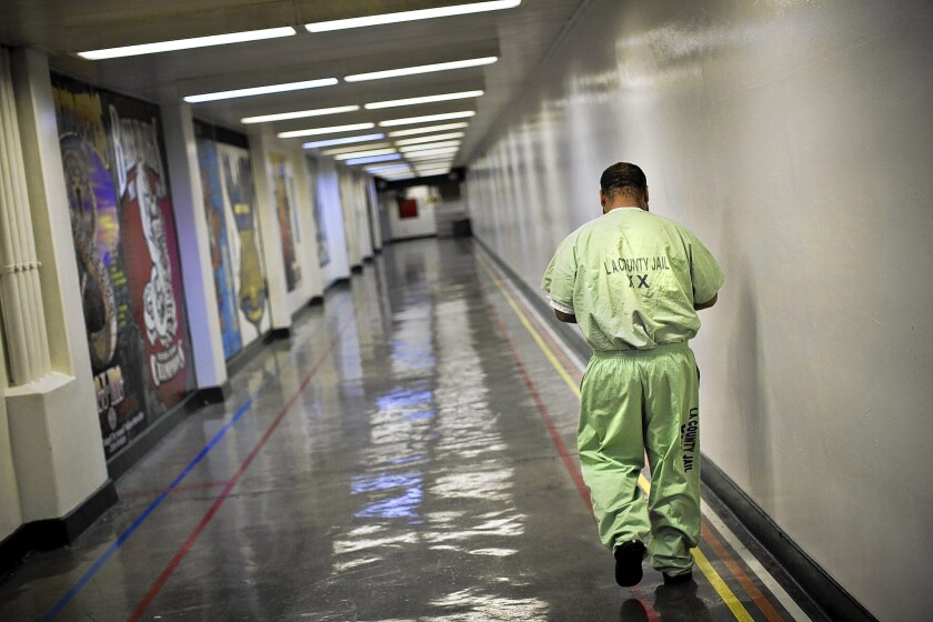 An inmate walks a corridor at the Men's Central Jail in downtown L.A. Concerned about deteriorating facilties, county supervisors want the jail replaced.