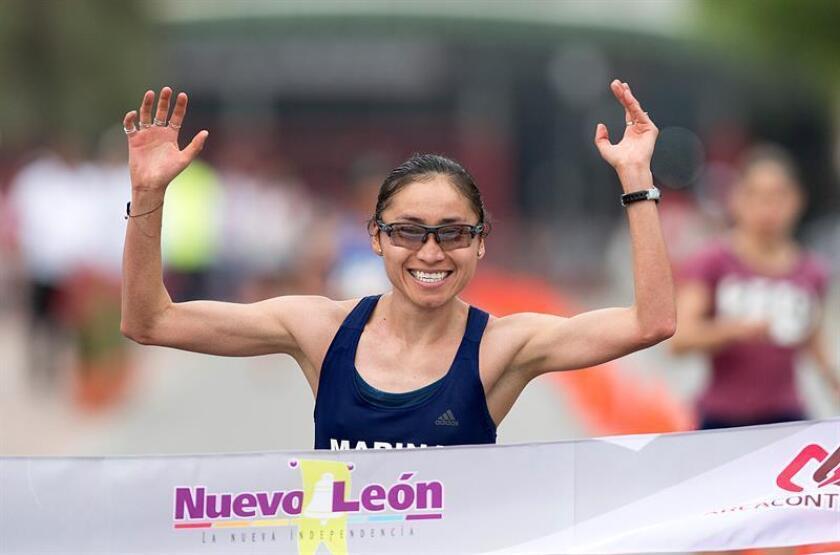 La marchista de México Guadalupe González cruza la meta en la prueba de 20 kilómetros marcha, rama femenina, segunda parada del circuito mundial de marcha, que se celebra en Monterrey (México). González ocupó el primer lugar en la competencia. EFE