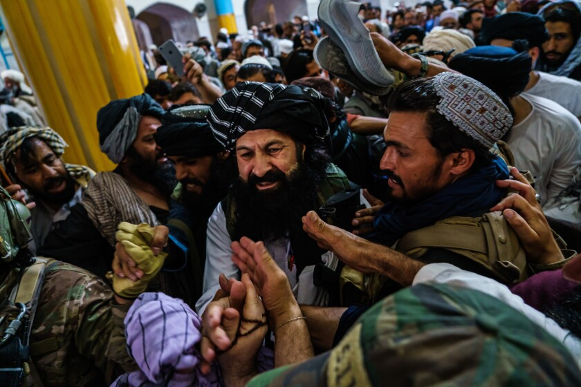 A crush of men at an Afghan mosque