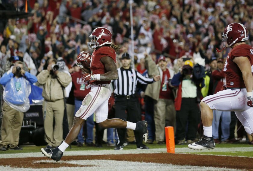 Alabama running back Derrick Henry (2) runs into the end zone for a touchdown against LSU in the second half of an NCAA college football game Saturday, Nov. 7, 2015, in Tuscaloosa , Ala. (AP Photo/John Bazemore)