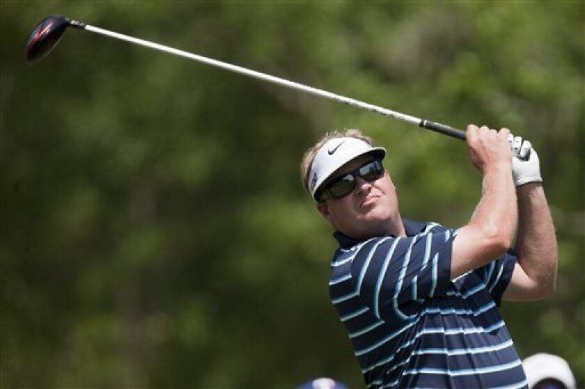 Carl Pettersson tees off from the second hole during the third round of the Houston Open golf tournament on Saturday, March 31, 2012, in Humble, Texas. (AP Photo/Eric Kayne)
