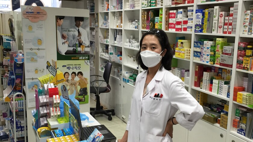 """Jang Jee-in at Hana Pharmacy in central Seoul. Asked if she believes the masks can prevent MERS transmission, Jang says, """"Not perfectly, but they can help."""""""