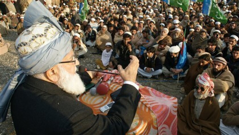 In this picture taken on Feb 13, 2012, Pakistan's anti-American religious leader Qazi Hussain Ahmed, left, campaigns against resumption of NATO supplies to neighboring Afghanistan, among Pakistani tribal people at Pakistani town Shalman situated Afghanistan border. Pakistan announced that it has be