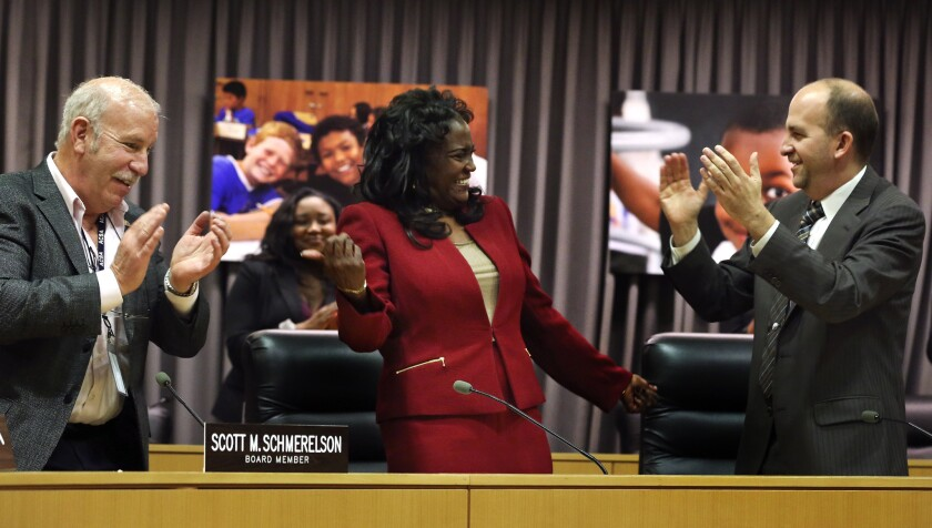 Michelle King, center, receives applause from L.A. Unified board member Scott Schmerelson, left, and board President Steve Zimmer after being named on Monday as the district's new superintendent.