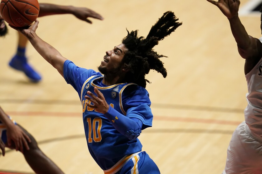 UCLA guard Tyger Campbell shoots during the first half against San Diego State.