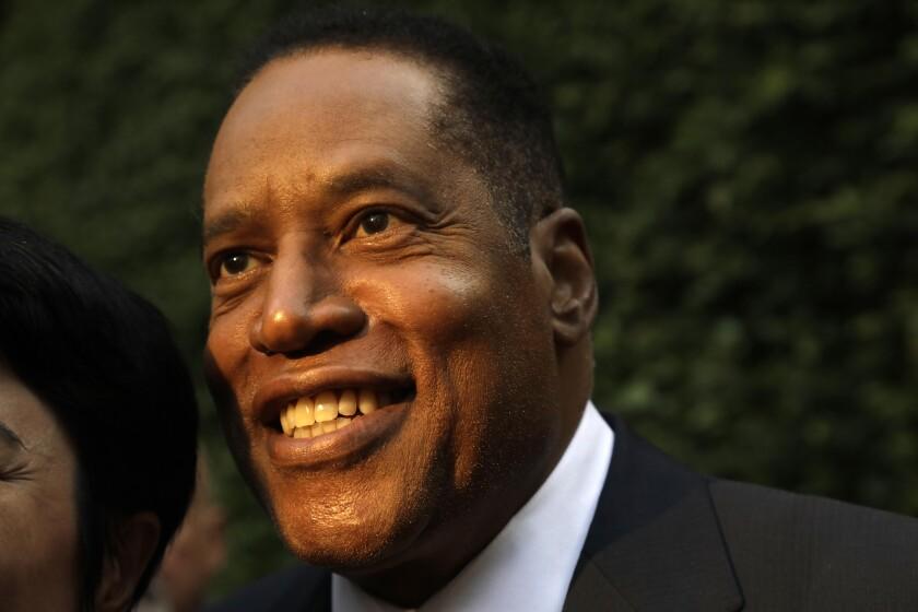 A closeup of Larry Elders smiling.