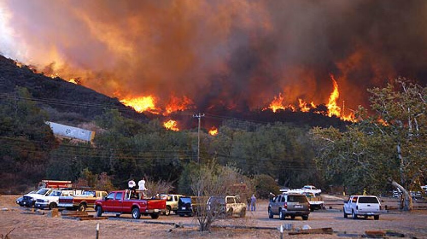 Modjeska Canyon erupts in flames near Santiago Canyon Road. The Santiago fire has charred more than 18,000 acres since it started Sunday afternoon.