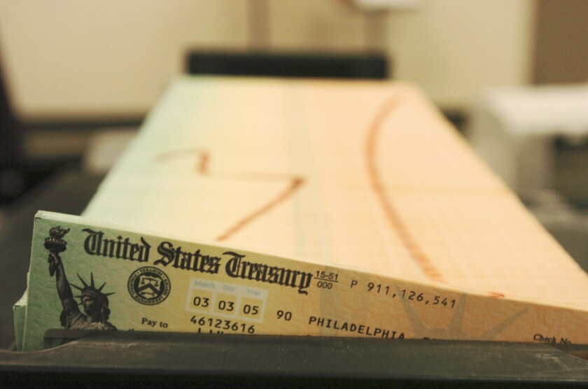 Trays of printed Social Security checks