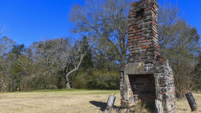 FILE - In this Tuesday, Jan. 29, 2019, file photo, a chimney, the last remaining original structure