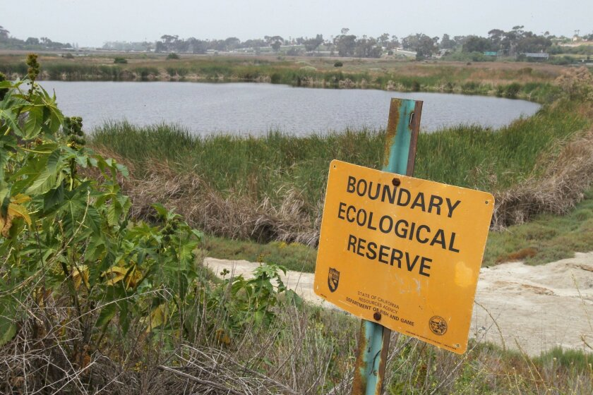 A sign along Jefferson Street marks the boundary of the ecological reserve at the Buena Vista Lagoon in Oceanside.
