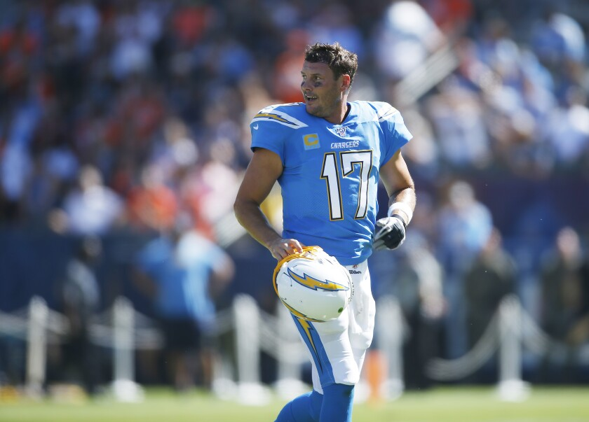 Los Angeles Chargers QB Philip Rivers walks off the field after a drive-ending incomplete pass in the second quarter against the Denver Broncos in Carson.