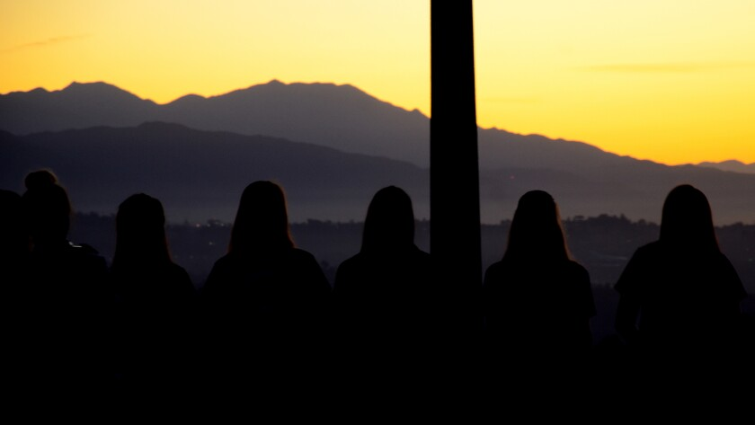People line up to watch a sunrise.