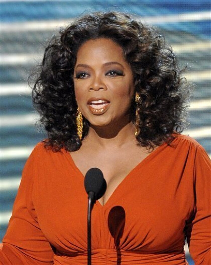In this Sept. 21, 2008 file photo, Oprah Winfrey opens the 60th Primetime Emmy Awards in Los Angeles. (AP Photo/Mark J. Terrill, file)