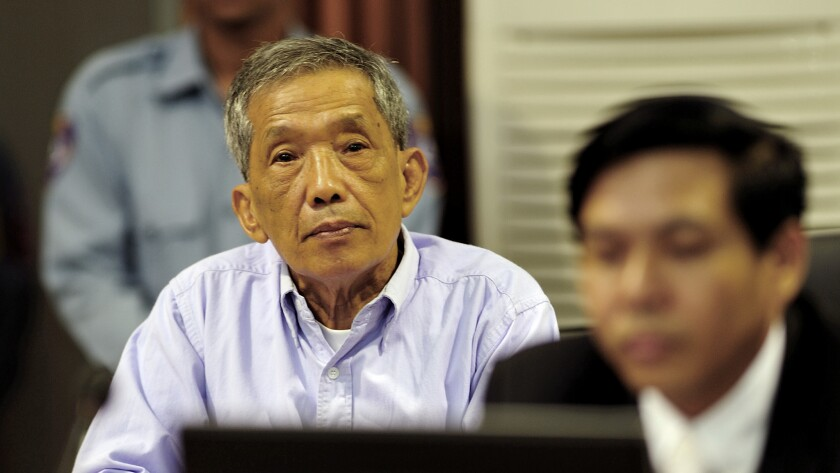 Kaing Guek Eav, also known as Duch, sits in court July 26, 2010, in Phnom Penh province.